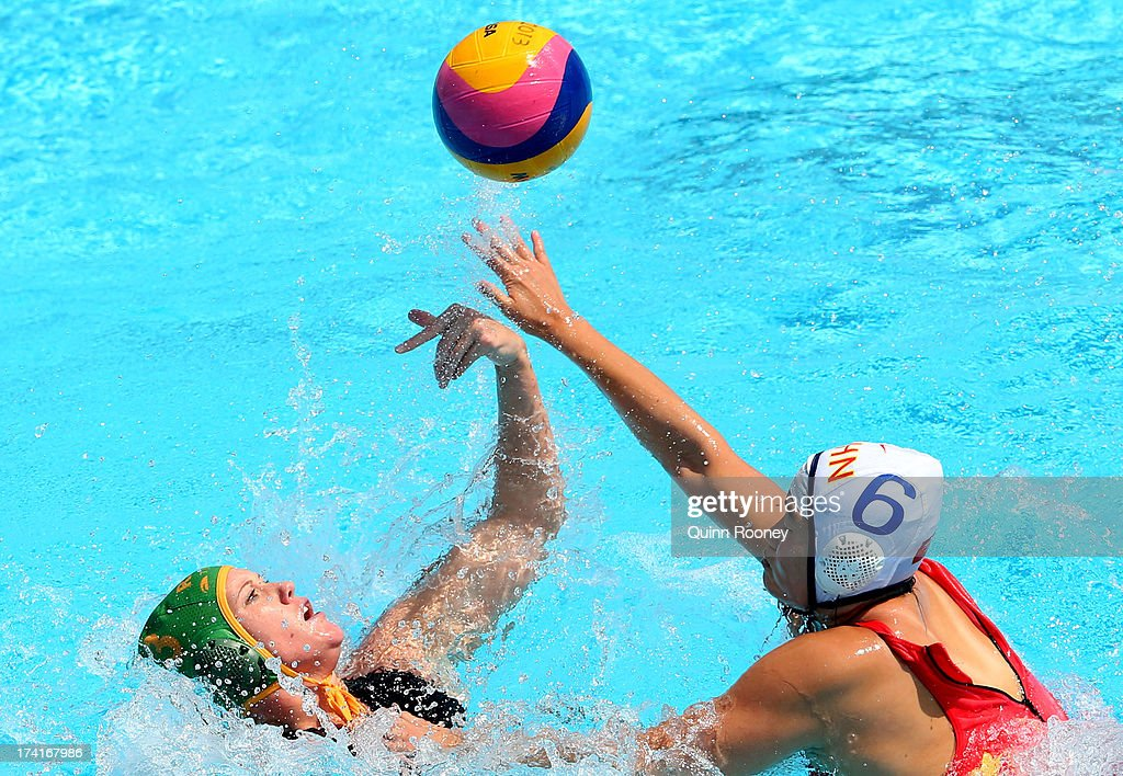 Sun Yating of China passes the ball under pressure during the Women's Water Polo first preliminary round match between China and South Africa during Day Two of the 15th FINA World Championships at Piscines Bernat Picornell on July 21, 2013 in Barcelona, Spain.