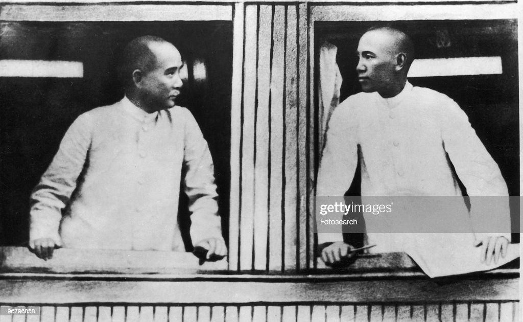 Sun Yat-sen and Chiang Kai-shek looking out a window, circa 1890s. (Photo by Fotosearch/Getty Images).