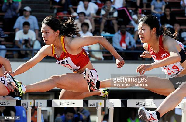 Sun Yawei of China competes with Ayako Kimura of Japan during the women's 100metre hurdle finals at the 2011 Asian Athletics Championships in Kobe on...