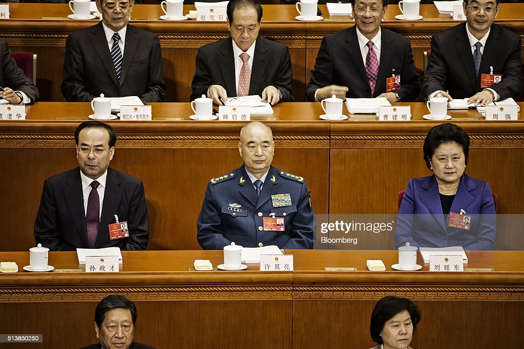 Sun Zhengcai, Chinese Communist Party secretary of Chongqing, left, Xu Qiliang, vice chairman of China's Central Military Commission, center, and <a gi-track='captionPersonalityLinkClicked' href=/galleries/search?phrase=Liu+Yandong&family=editorial&specificpeople=4375362 ng-click='$event.stopPropagation()'>Liu Yandong</a>, vice premier of China, attend the opening of the fourth session of the 12th National People's Congress (NPC) at the Great Hall of the People in Beijing, China, on Saturday, March 5, 2016. China unveiled a looser fiscal stance and pledged to accelerate the restructuring of its bloated state-owned industries in setting a weaker growth target for this year. Photographer: Qilai Shen/Bloomberg via Getty Images