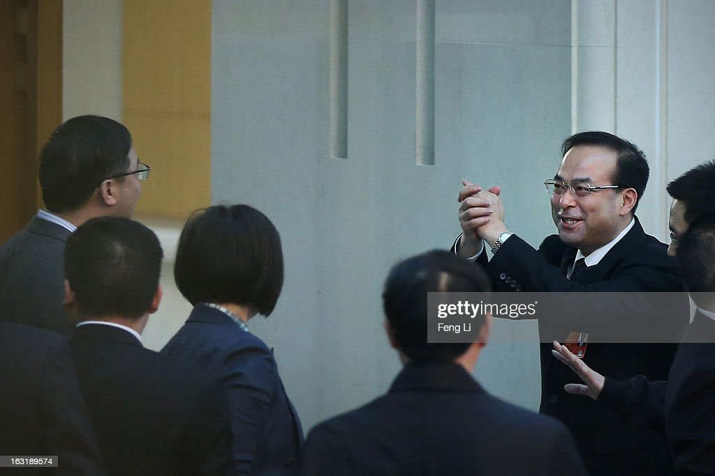 Sun Zhengcai, member of the Political Bureau of the CPC Central Committee and Chongqing Municipality Communist Party Secretary, holds fist salute as he leaves the Chongqing delegation's group meeting during the annual National People's Congress at the Great Hall of the People on March 6, 2013 in Beijing, China. Sun answers media's question Wednesday that he knows nothing about the trial of Bo Xilai. The 12th National People's Congress goes on till March 17th.