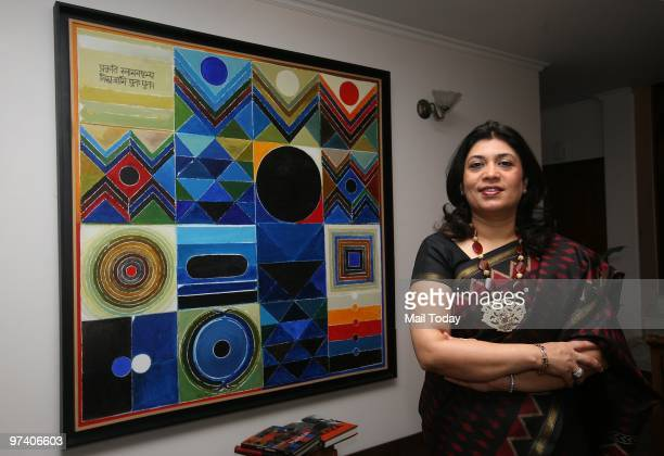 Sunaina Anand of Art Alive gallery poses with her favourite Raza canvas titled Pancha Tatva in New Delhi on February 24 2010 The painting caught the...