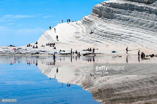 TURCHI REALMONTE SICILY ITALY Sunbakers at Scala dei Turchi or Stairs of the Turks at Realmonte southern Sicily Italy The Scala is formed by marl a...