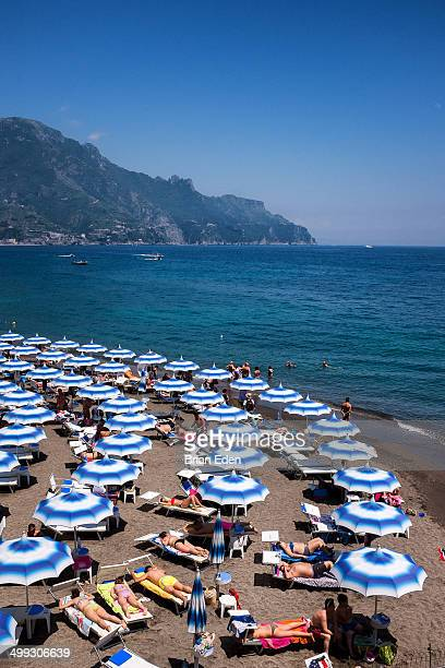 Sunbathers and umbrellas on a beach in Amalfi
