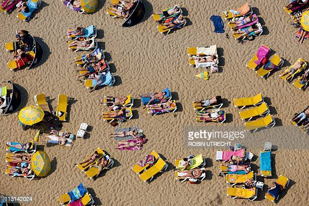 Sunbathers enjoy the beautiful weather in this aerial shot in Scheveningen on April 24 2011 AFP PHOTO/ANP/ROBIN UTRECHT netherlands out belgium out
