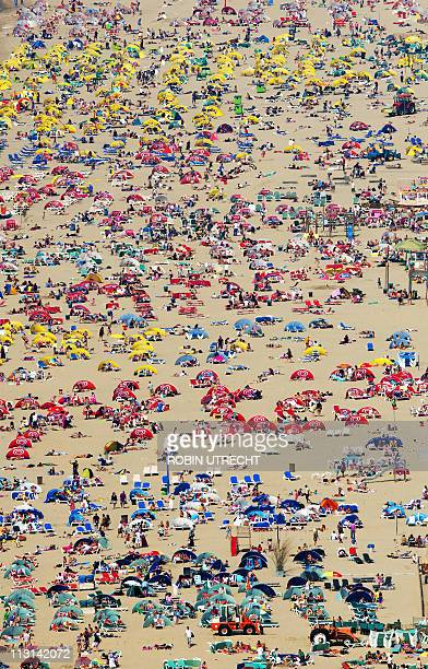 Sunbathers enjoy the beautiful weather in this aerial shot of the beach of Zandvoorton on April 24 2011 AFP PHOTO/ANP/ROBIN UTRECHT netherlands out...