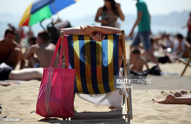 A sunbathers enjoys the sunshine on the beach on May 25 2012 in Bournemouth England Temperatures in parts of the UK are expected to reach over 27...