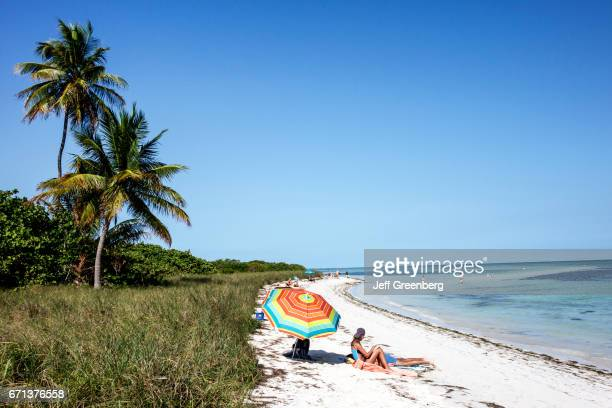 Sunbathers on the beach at Bahia Honda State Park