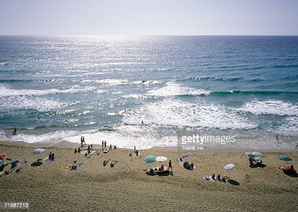 Sunbathers on the Beach at Marina di Arbus - High Angle View Out to Sea