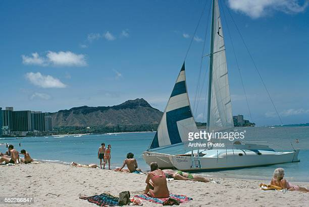 Sunbathers on Waikiki Beach Honolulu Hawaii USA June 1971