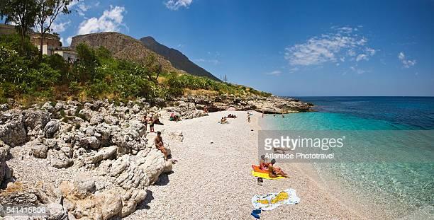 Sunbathers relaxing on beach at Zingaro Natural Reserve
