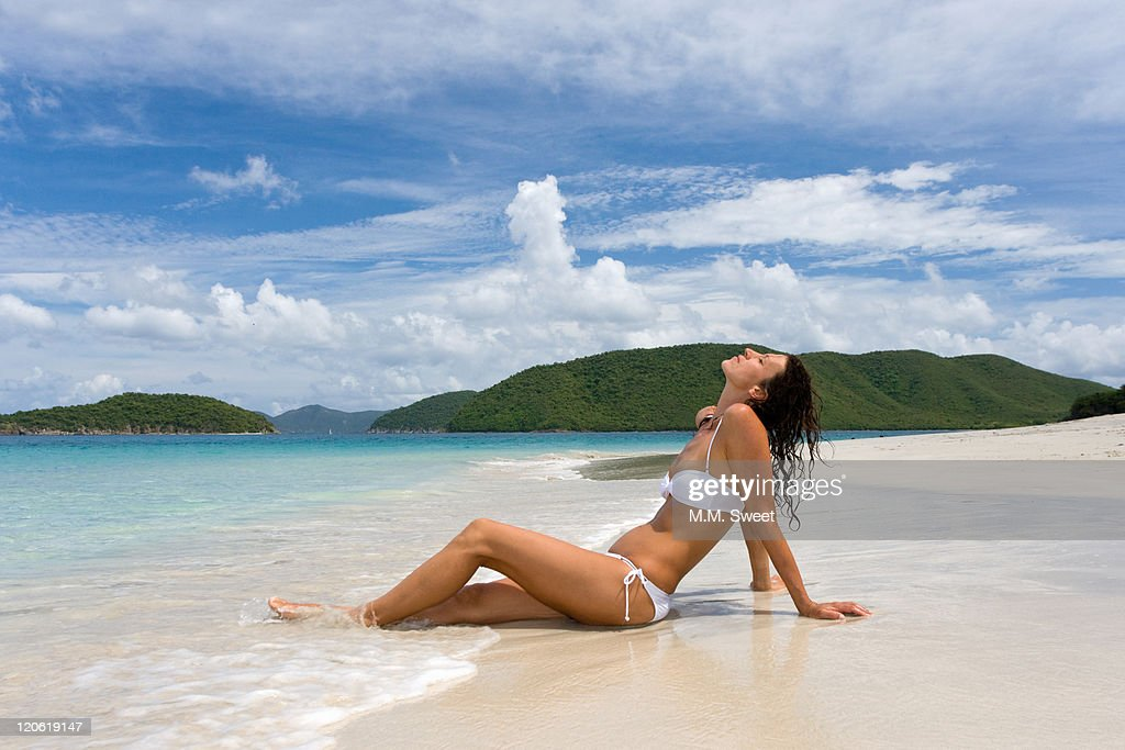 Sunbathing on remote Caribbean beach : Stock Photo