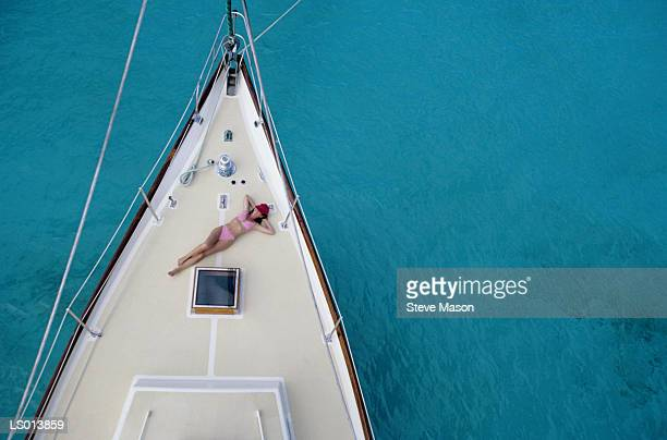 Sunbathing on the Deck of a Yacht