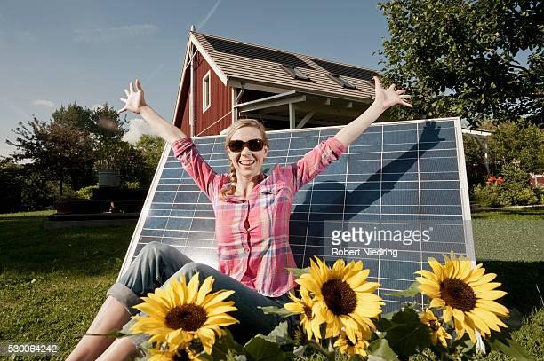 Sunbathing solar panel woman garden happy