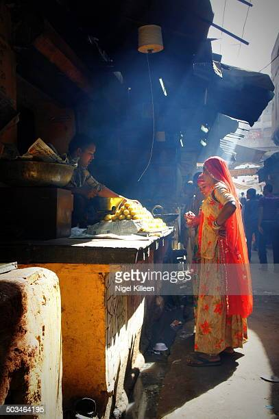 Sunbeam illuminating a smokey street food alley Pushkar Rajasthan India
