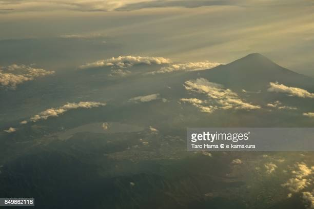 Sunbeam on Mt. Fuji and Lake Kawaguchi in Yamanashi prefecture sunset time aerial view from airplane