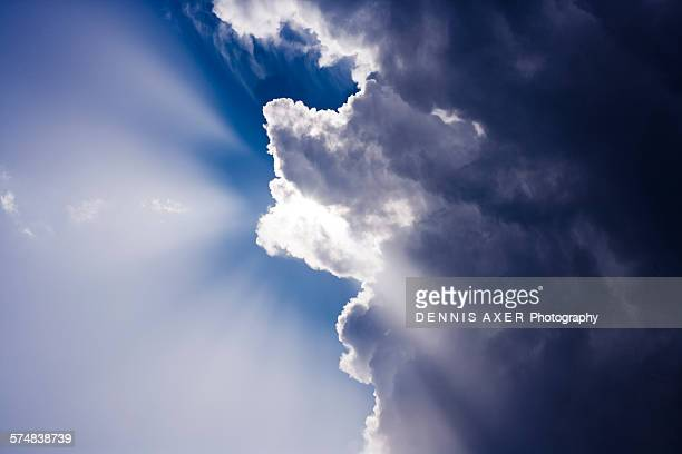 Sunbeams behind clouds