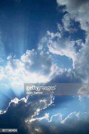 Sunbeams filtering through clouds : Stock Photo