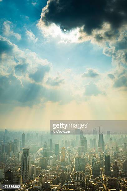 Sunbeams illuminating Shanghai skyscrapers crowded skyline futuristic cityscape China
