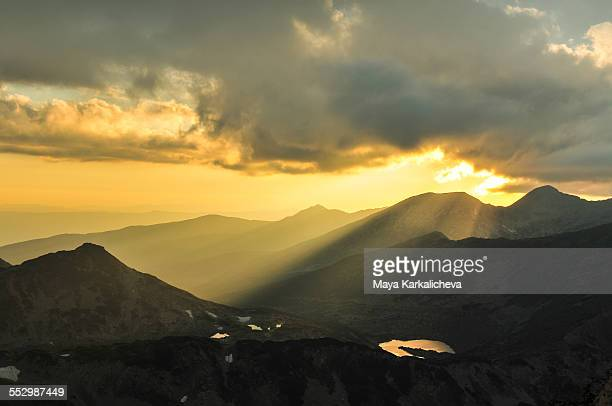 Sunbeams in a mountain at sunset