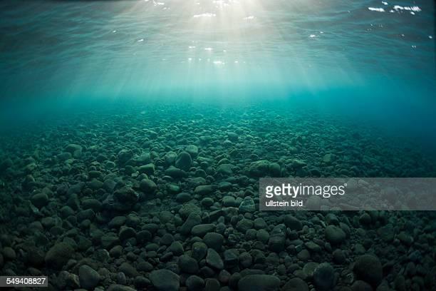 Sunbeams on Stones at Shore Alam Batu Bali Indonesia