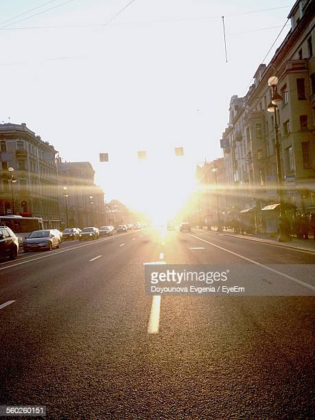 Sunbeams Over City Street With Cars