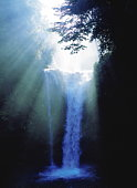 Sunbeams over waterfall