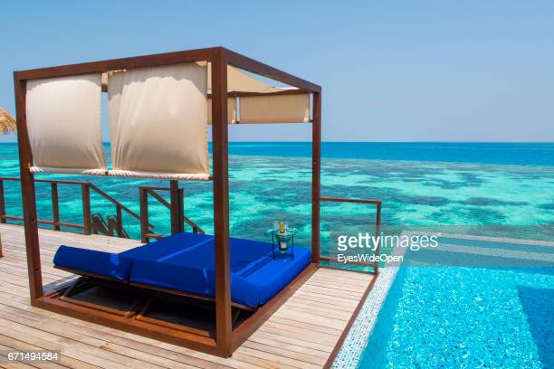 Sunbed with a Bottle of Champagne and the Pool at the Terrace Deck of a Water Villa at Coco Bodu Hiti NorthMaleAtoll on February 23 2017 in Male...