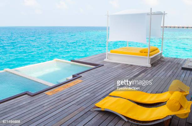 Sunbeds and Infinity Pools at Coco Bodu Hiti NorthMaleAtoll on February 25 2017 in Male Maldives