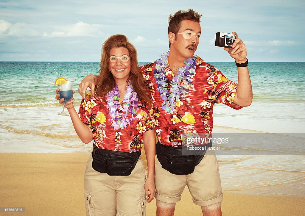 A sunburnt couple of tourists at the beach : Stock Photo