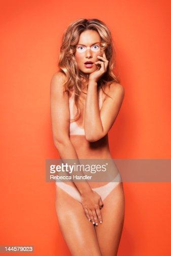 Sunburnt Nude Woman with bikini tan lines : Stock Photo