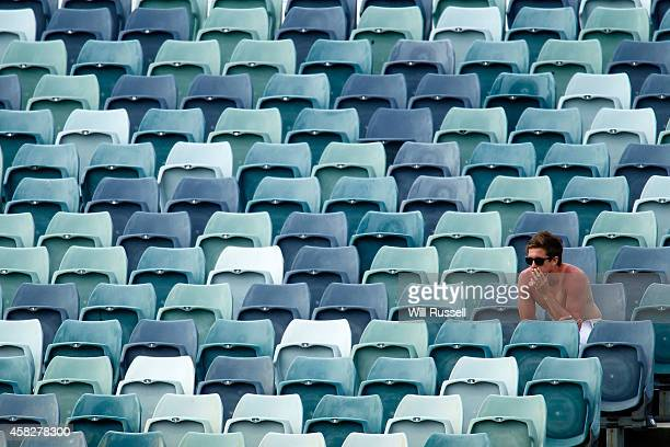 A sunburnt spectator watches the action during day three of the Sheffield Shield match between Western Australia and Tasmania at WACA on November 2...