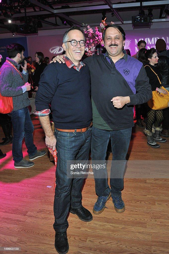 Sundance Film Festival Director John Cooper (L) and producer Rohit Khattar attend the Sundance Institute Mahindra Global Filmmaking Award Reception at Sundance House on January 22, 2013 in Park City, Utah.