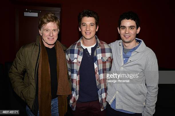 Sundance Institute President and Founder Robert Redford Actor Miles Teller and Filmmaker Damien Chazelle attend the premiere of 'Whiplash' at the...