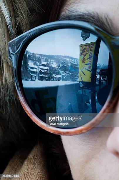 Sundance signage is seen in the reflection of a woman's sunglasses before the 2016 Sundance Film Festival on January 20 2016 in Park City Utah