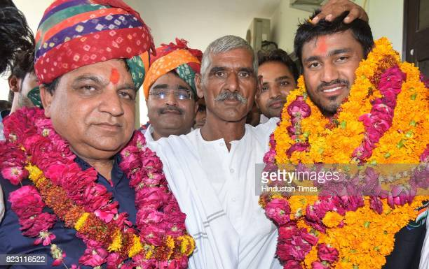 Sundar Singh Gujjar gold medalist World ParaAthletics Championships with his father Kanwar Singh and coach Mahavir Singh at SMS Stadium on July 26...