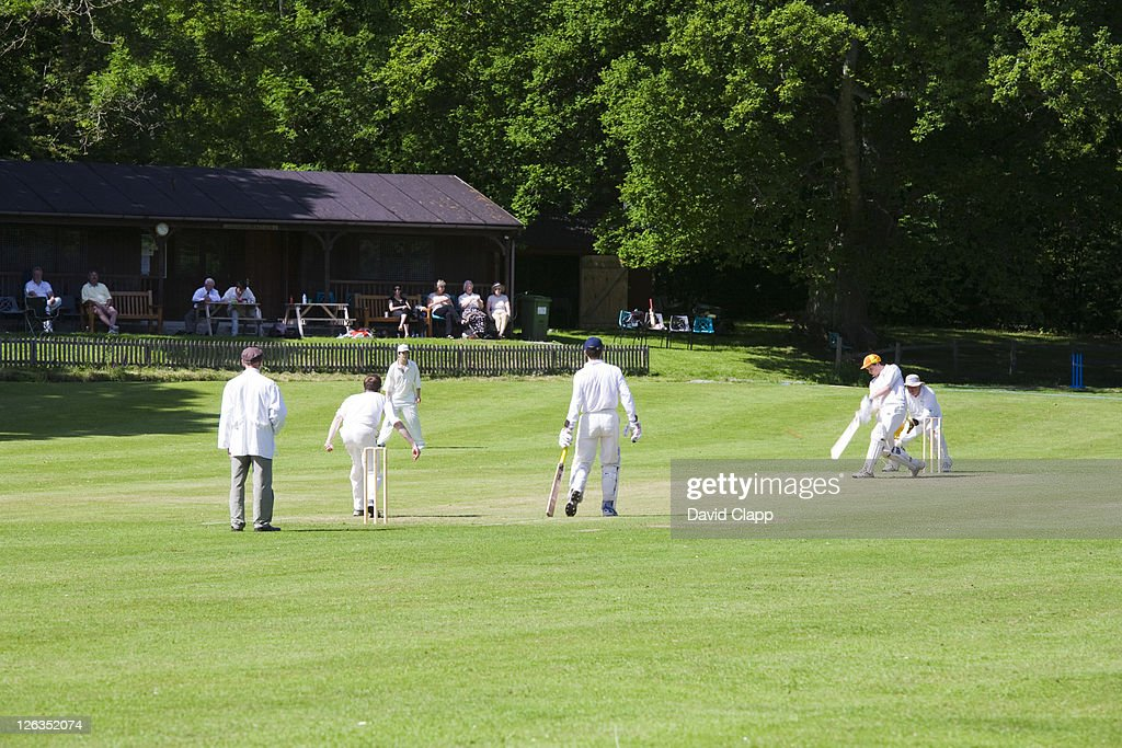 Sunday afternoon cricket on the cricket field in the village of Lustleigh. : Stock Photo