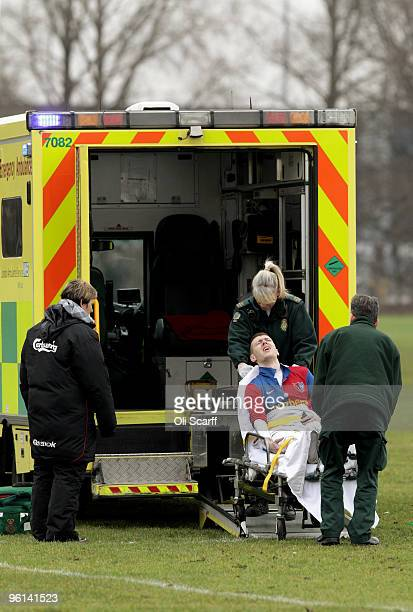 Sunday League footballer grips his leg in pain as he is lifted into the back of an ambulance by paramedics on the Hackney Marshes pitches on January...