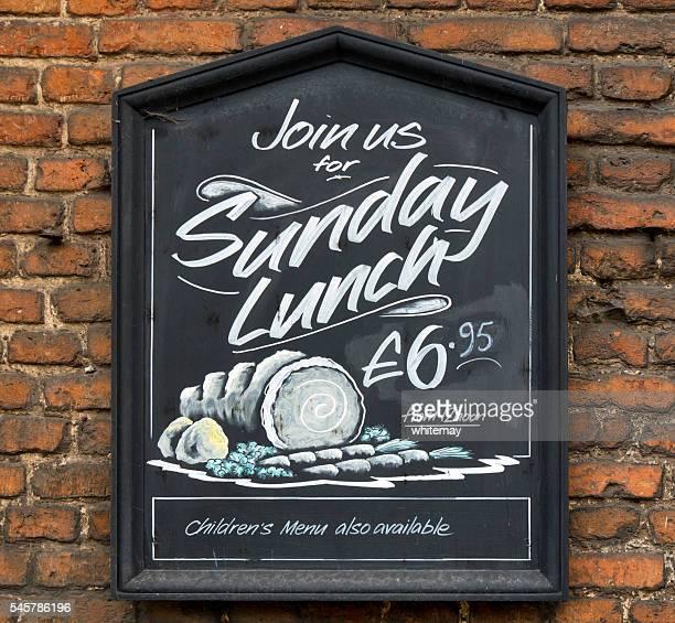 Sunday lunch menu board outside a pub
