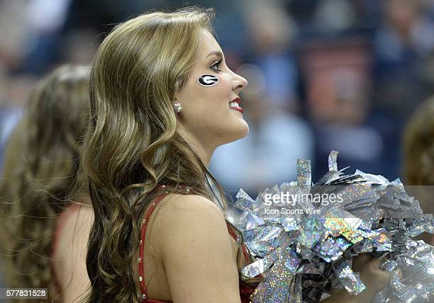 A Georgia Lady Bulldog cheerleader looks on during the first half in the 1st round of the 2014 Div 1 NCAA Womens Basketball Championship between...