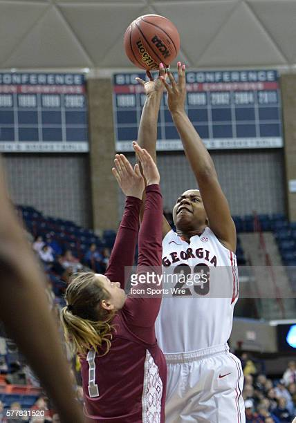 Georgia Lady Bulldogs forward Halle Washington shoots over Saint Joseph Hawks forward Ilze Gotfrida during the first half in the 1st round of the...