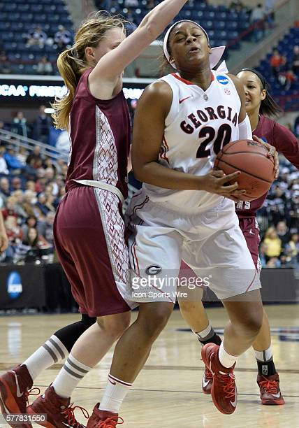 Georgia Lady Bulldogs forward Shacobia Barbee looks to make a play down low against Saint Joseph Hawks guard Erin Shields during the first half in...