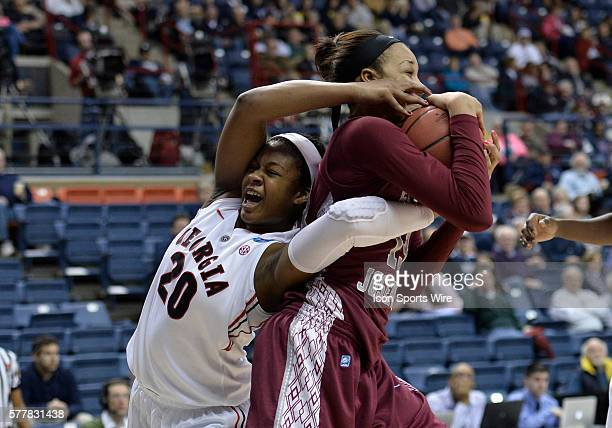 Saint Joseph Hawks forward Ashley Robinson and Georgia Lady Bulldogs forward Shacobia Barbee battle for control of the ball during the first half in...