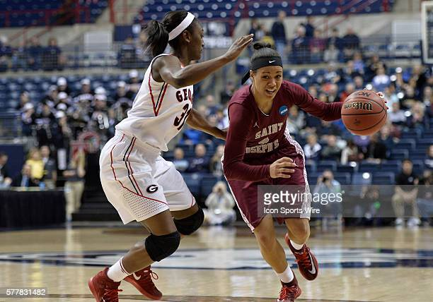 Saint Joseph Hawks guard Natasha Cloud dribbles up court against Georgia Lady Bulldogs guard Erika Ford during the first half in the 1st round of the...