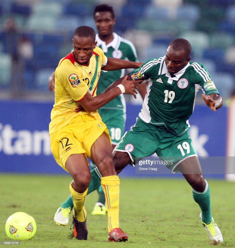 Sunday Mba of Nigeria fights for the ball with Seydou Keita of Mali during the 2013 African Cup of Nations Semi-Final match between Mali and Nigeria at Moses Mahbida Stadium on February 06, 2013 in Durban, South Africa.