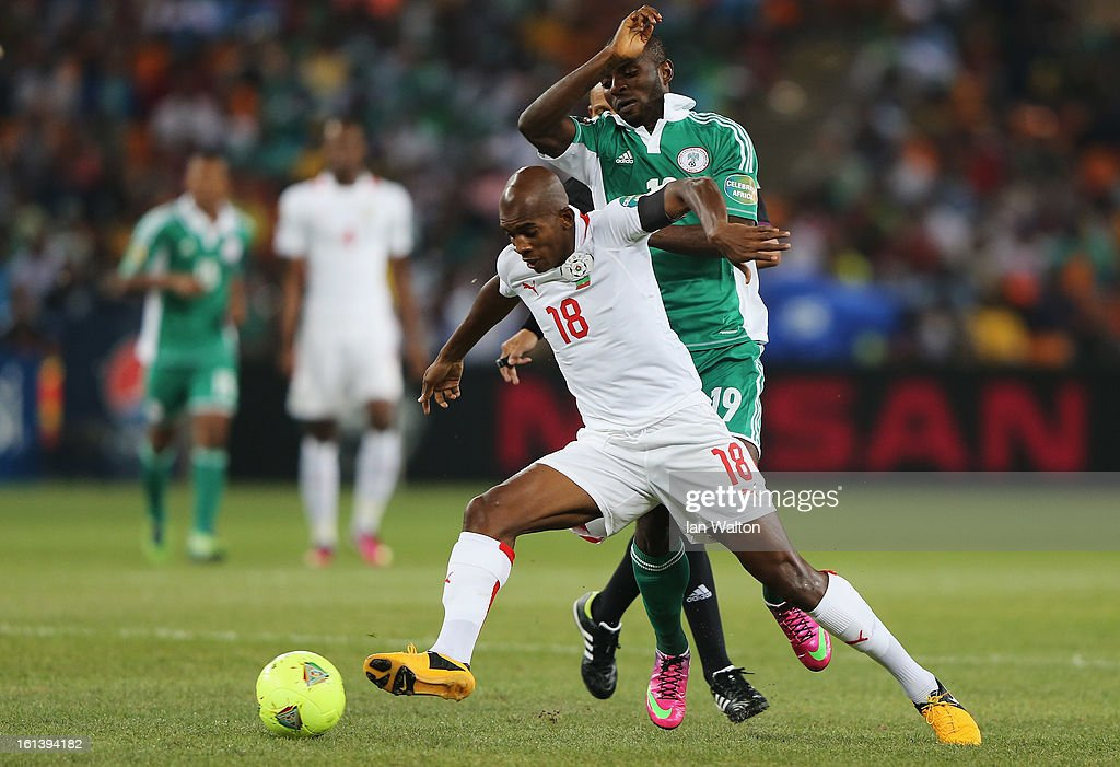 Sunday Mbah of Nigeria is tackled by Charles Kabore of Burkina Faso during the 2013 Africa Cup of Nations Final match between Nigeria and Burkina at FNB Stadium on February 10, 2013 in Johannesburg, South Africa.