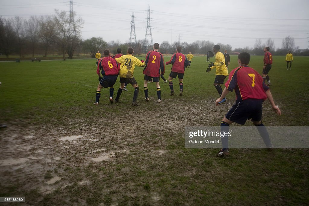A Sunday Morning Game Of Football Takes Place During Miserable Cold And Rainy Weather On