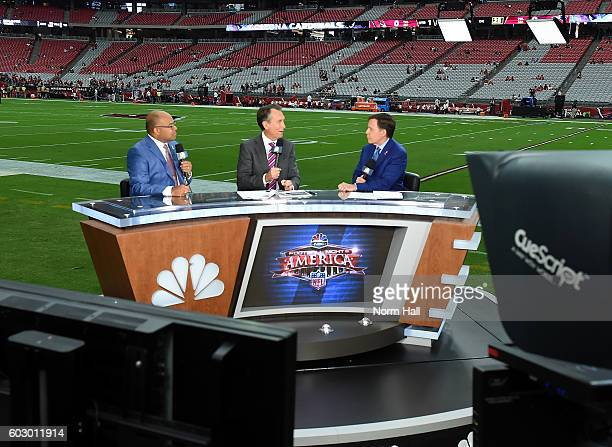 Sunday Night Football Commentators Mike Tirico Cris Collinsworth and Bob Costas report prior to the NFL game between the New England Patriots and...