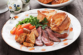 Traditional british sunday roast with yorkshire pudding, roasted potato and vegetables