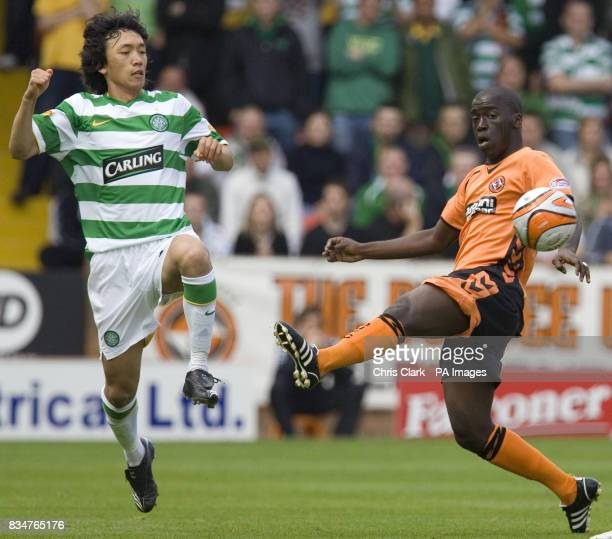 Sundee United's Morgaro Gomis battles with Celtic's Shunsuke Nakamura during the Clydesdale Bank Scottish Premier League match at Tannadice Park...